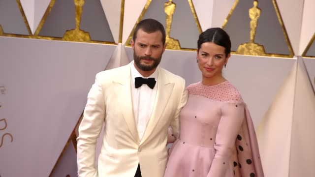 jamie dornan and amelia warner at 89th annual academy awards - arrivals at hollywood & highland center on february 26, 2017 in hollywood, california.... - hollywood and highland center stock videos & royalty-free footage