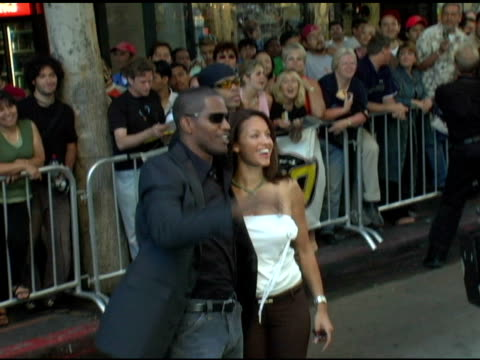 jamie foxx and leila arcieri at the 'collateral' los angeles premiere at the orpheum theatre in los angeles, california on august 2, 2004. - orpheum theatre stock videos & royalty-free footage