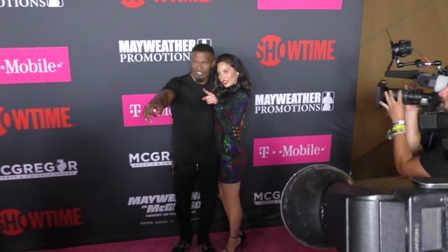 Jamie Foxx and Olivia Munn at The Floyd Mayweather Jr vs Conor McGregor Bout PreEvent VIP Party Magenta Carpet on August 26 2017 in Las Vegas Nevada