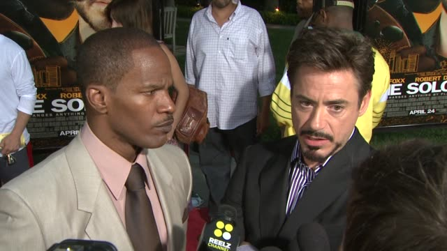 jamie foxx and robert downey jr. on what jamie has in common with nathaniel ayers, making sure the script reflected that nathaniel was not exploited... - soloist stock videos & royalty-free footage