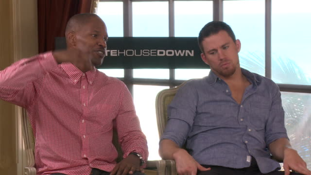 Jamie Foxx giving Channing Tatum parenthood tips in Cancun 2013 at the White House Down interview