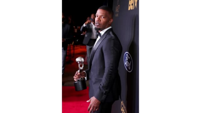 jamie foxx poses with the outstanding supporting actor in a motion picture award for just mercy at the 51st naacp image awards presented by bet at... - best supporting actor stock videos & royalty-free footage