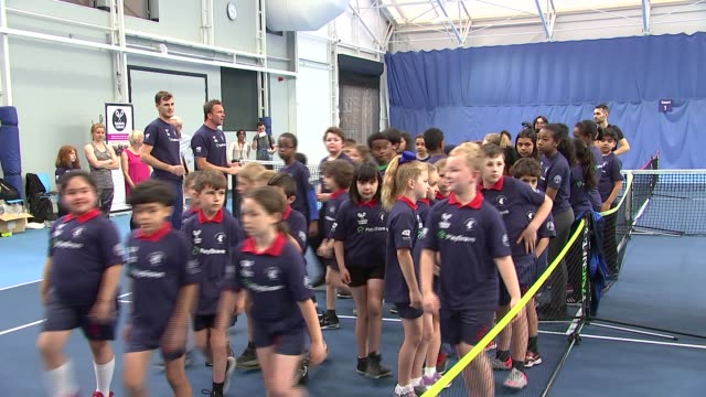 jamie murray passes on tips to children in roehampton england london roehampton int tennis balls on floor with children training in background... - image manipulation stock videos and b-roll footage