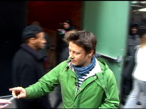 jamie oliver departs 'good morning america' in new york 04/6/11 - jamie oliver stock videos & royalty-free footage