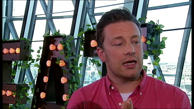 jamie oliver launches 'food revolution day' at city hall; jamie oliver interview sot - re 'food revolution day' - jamie oliver stock videos & royalty-free footage