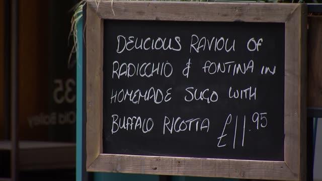 jamie oliver restaurants 'jamie's'; england: london: ext 'jamie's italian' sign / menu sign 'ravioli'/ 'jamie oliver in st paul's' sign in window /... - jamie oliver stock videos & royalty-free footage