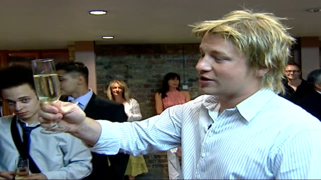 jamie oliver's fifteen restaurant: students preparing for graduation / jamie oliver interview; chef jamie oliver gathering trainees around as... - jamie oliver stock videos & royalty-free footage
