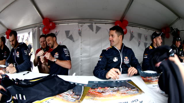 Jamie Whincup driver of the Red Bull Holden Racing Team Holden Commodore ZB signs autographs during previews ahead of the Bathurst 1000 which is part...