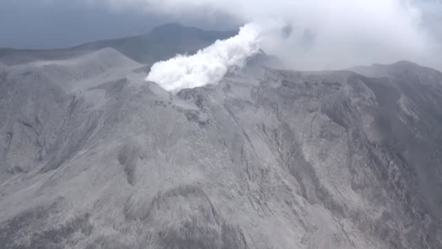 tokyo jan 17 :a volcano erupted on a southwestern japan island on thursday the weather agency said - honshu stock videos and b-roll footage