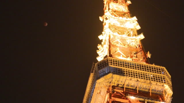 jan 2018 lunar eclipse and tokyo tower, japan - jp201806 stock videos and b-roll footage