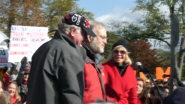 jane fonda attends climate change protest in washington dc; usa: washington dc: ext further shots of jane fonda seated on stage listening to speakers... - 創始者点の映像素材/bロール