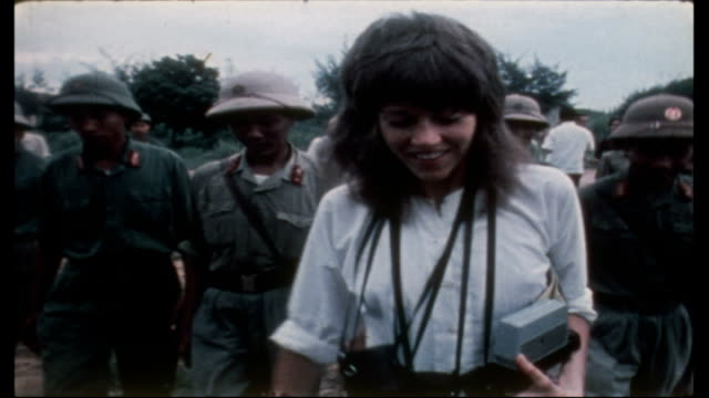 jane fonda visits anti aircraft battery camp; upitn north vietman: hanoi: ext / jane fonda shaking hands with troops and smiling: cms fonda towards... - vietnam stock videos & royalty-free footage