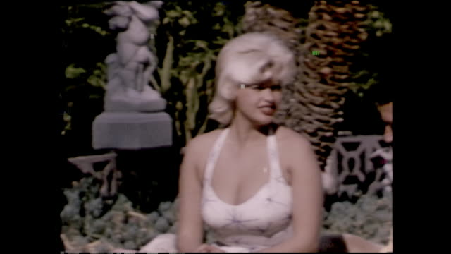 jane mansfield at her home with mickey hargitay lifting small weights talking swimming in their heart shaped pool some dialog - mickey hargitay stock videos & royalty-free footage