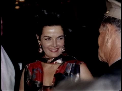 stockvideo's en b-roll-footage met jane russell and many stars arrive at event for princess margaret hollywood at night klieg lights red carpet event - 1965