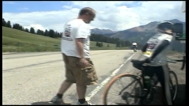 video diary usa west virginia int jane tomlinson interview sot passing motorist threw bottle of coke at us/ climbing monarch pass toughest day so far... - virginia us state stock videos and b-roll footage