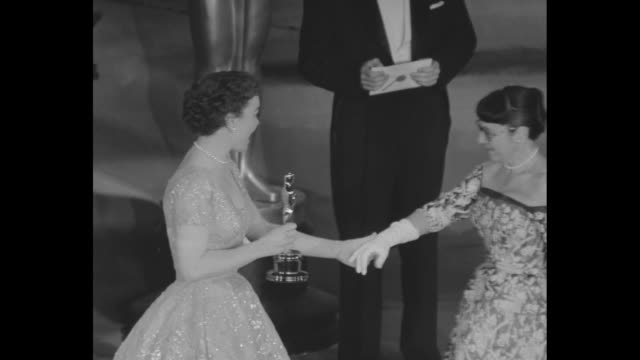 Jane Wyman presents Best Costurme Design Oscar to Edith Head Paramount costume designer / audience applauds / Lauren Bacall presents Award of Merit...