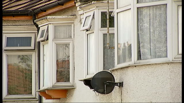 man claims he killed girlfriend in 'selfdefence' street houses on street pan windows and satellite dish reporter to camera - self defence stock videos & royalty-free footage
