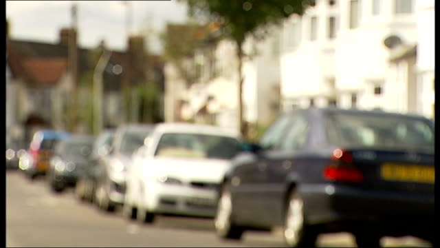 man claims he killed girlfriend in 'selfdefence' van along street blurred 'fairlands avenue' road sign cars parked along street - self defence stock videos & royalty-free footage