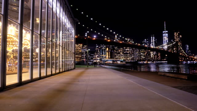jane's carousel, brooklyn bridge and manhattan financial district - waterfront stock videos & royalty-free footage