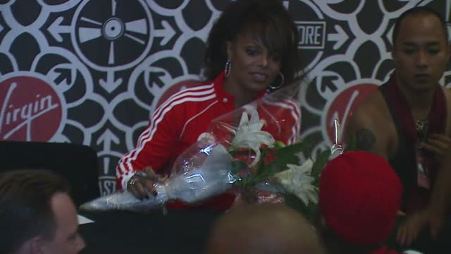 janet jackson at the janet jackson signing copies of her new cd '20 yo' at virgin megastore times square in new york, new york on september 26, 2006. - megastore stock videos & royalty-free footage