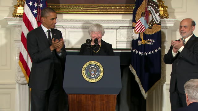 vídeos de stock, filmes e b-roll de janet yellen shakes obamas hand and steps up to podium - business or economy or employment and labor or financial market or finance or agriculture
