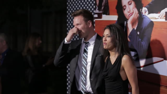 Janina Gavankar and Jim Parrack posing for paparazzi on the red carpet at the Paramount Theater