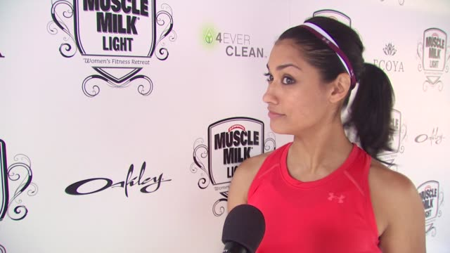 Janina Gavankar on what brings her out to the Muscle Milk women's fitness retreat whether she prefers the gym or classes to stay in shape and how...