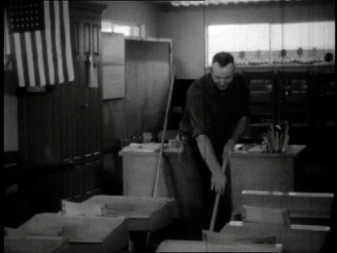 1950 b/w janitor mopping floor in house converted to classroom / wayne, ohio, united states - anno 1950 video stock e b–roll