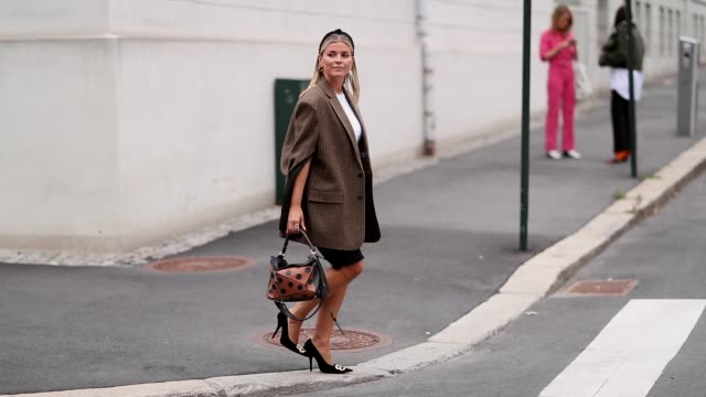 Janka Polliani wearing a corduroy blazer and Loewe bag seen is outside the 'Moire' show during Oslo Runway SS19 on August 15 2018 in Oslo Norway