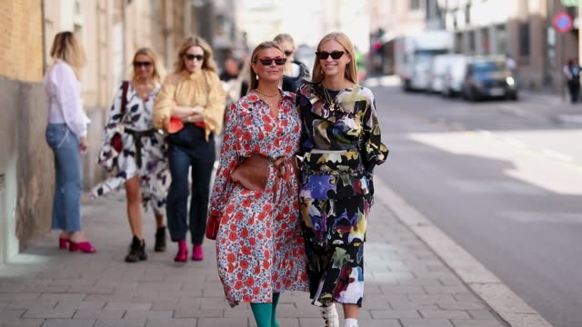 Janka Polliani wearing dress and Tine Andrea wearing blue dress with floral print during Oslo Runway SS19 on August 14 2018 in Oslo Norway