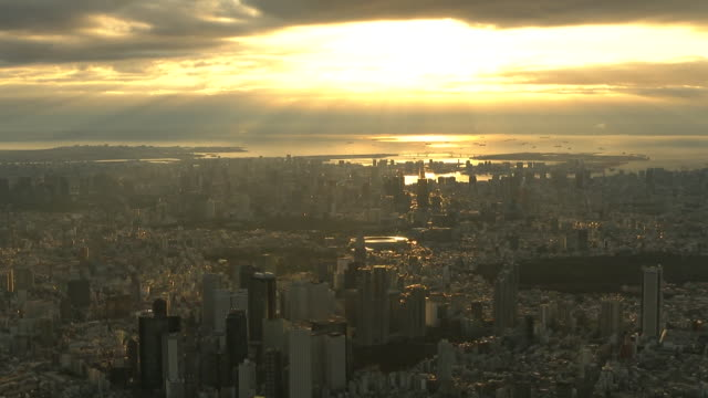 am, aerial shot of tokyo skyline with japan national stadium, also called olympic stadium, lit by the first sunrise of the year; the stadium was... - tokyo japan stock videos & royalty-free footage