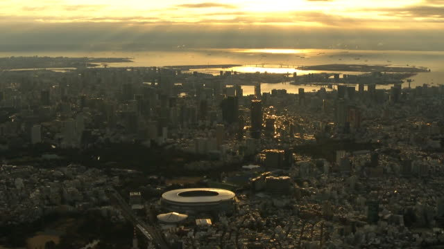 38 am aerial shot tokyo skyline in the first sunrise of the year zoom into japan national stadium also called olympic stadium the stadium was... - sunrise dawn stock videos & royalty-free footage
