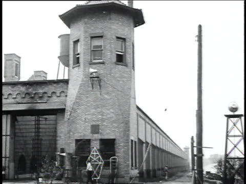 january 1 1934 ws entrance to indiana state prison with two guards in front / michigan city indiana united states - bankräuber stock-videos und b-roll-filmmaterial