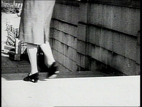 january 1, 1943 woman walks down stairs / england - 1943 stock videos & royalty-free footage