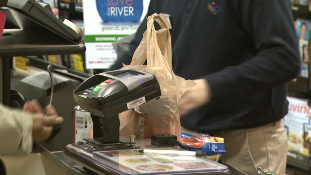 january 1, 2010 cashier ringing up grocery items at harris teeter food market / washington, d.c., united states - reusable bag stock videos & royalty-free footage