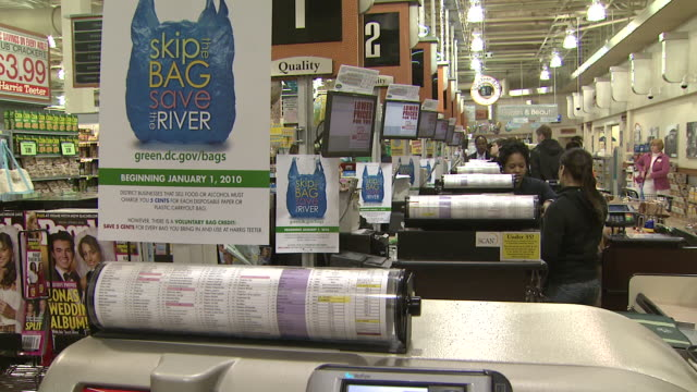 "january 1, 2010 shot of ""skip the bag save the river"" sign at harris teeter grocery checkout / washington, d.c., united states - reusable bag stock videos & royalty-free footage"