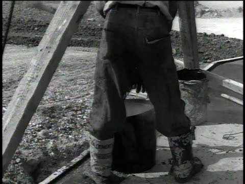 vídeos de stock e filmes b-roll de january 10, 1957 montage soldier carrying steaming buckets of tar to construction site / okinawa, japan - balde