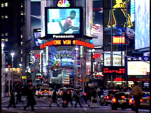 january 15 2000 ws pedestrians walking through times square in front of the jumbotron / new york new york united states - 2000 2010 stil bildbanksvideor och videomaterial från bakom kulisserna