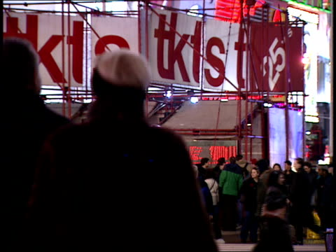january 15 2000 ws pedestrians walking through times square in front of tkts ticket booth / new york new york united states - 2000 2010 stil bildbanksvideor och videomaterial från bakom kulisserna