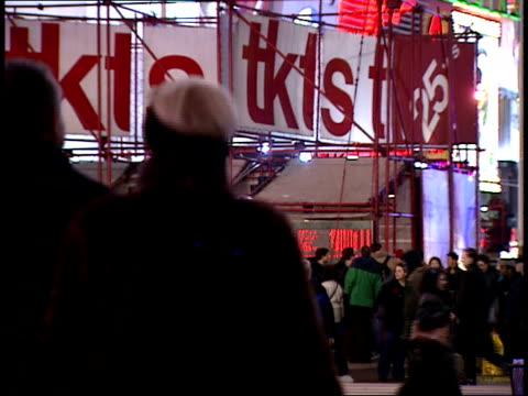 january 15, 2000 pedestrians walking through times square in front of tkts ticket booth / new york, new york, united states - 2000 2010 stil bildbanksvideor och videomaterial från bakom kulisserna