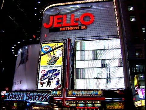 january 15 2000 pan various buildings billboards and pedestrians walking at the center of times square / new york new york united states - 2000 2010 stil bildbanksvideor och videomaterial från bakom kulisserna