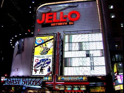 january 15, 2000 various buildings, billboards, and pedestrians walking at the center of times square / new york, new york, united states - 2000 2010 stil bildbanksvideor och videomaterial från bakom kulisserna