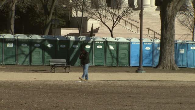 january 16, 2009 a line of portable toilets on the national mall / washington, d.c., united states - 新古典派点の映像素材/bロール