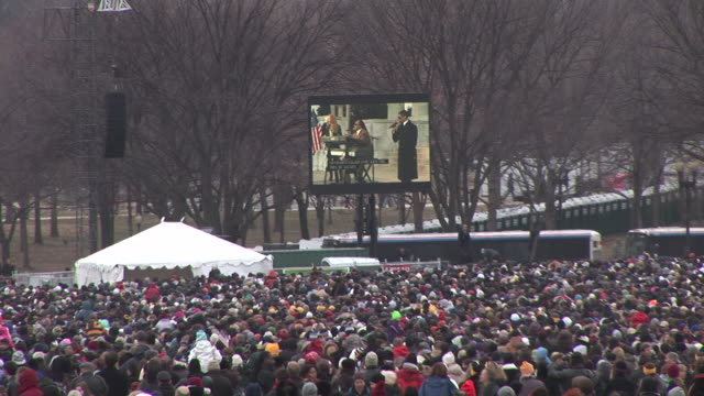 january 18 2009 film montage ws spectators at the 'we are one' concert on the national mall to celebrate the inauguration of barack obama/ shakira... - 2009 video stock e b–roll