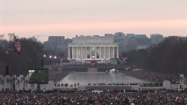 january 18 2009 ha ws large screens showing garth brooks performing at the 'we are one' concert on the national mall to celebrate the inauguration of... - 2009 video stock e b–roll