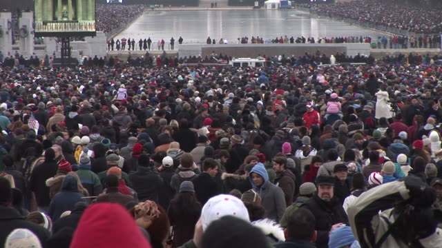 january 18 2009 ws spectators watching as large screens show samuel l jackson speaking at the 'we are one' concert on the national mall to celebrate... - 2009 video stock e b–roll