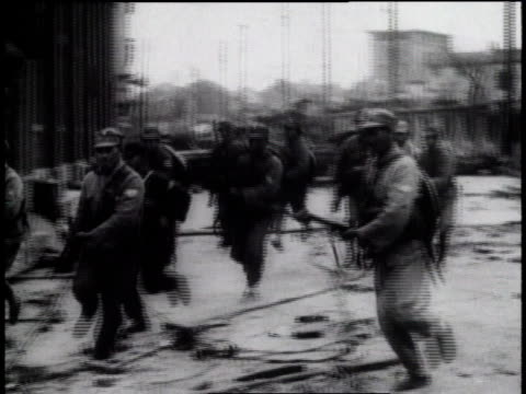 january 1932 montage soldiers with guns running down a street / shanghai international settlement - 1932 stock videos & royalty-free footage