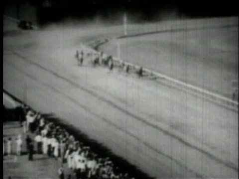 stockvideo's en b-roll-footage met january 1935 montage seabiscuit running in first race / hialeah, florida, united states - 1935