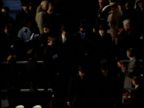 stockvideo's en b-roll-footage met january 20 1961 ws dignitaries wearing top hats making their way down steps of stadium as people applaud / washington dc united states - hogehoed