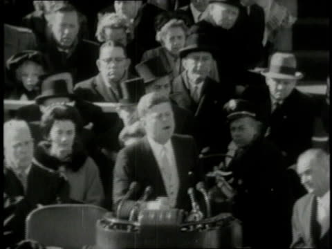 january 20 1961 montage president john f kennedy at his inauguration giving his ask not what your country can do for you speech / washington dc... - john f. kennedy politik stock-videos und b-roll-filmmaterial